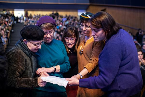 "Orthodox Jewish women are increasingly joining a custom called <em>Daf Yomi</em>, Hebrew for ""daily page,"" which involves reading a page a day of the Talmud, a centuries-old, multivolume collection of rabbinic teachings, debates and interpretations of Judaism. Here women read the last pages of the cycle at their first women's mass Talmud celebration in Jerusalem in January."