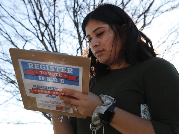 Karina Shumate, 21, a college student, filled out a voter registration form in Richardson, Texas on Jan. 18. One big registration effort this year has drawn controversy among elections officials.