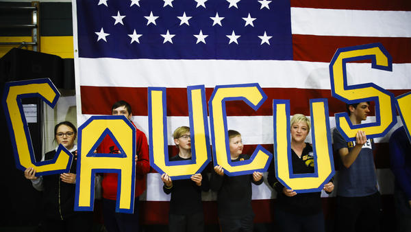 """Attendees hold letters that read """"CAUCUS"""" during a campaign event for Democratic presidential candidate and former South Bend, Ind., Mayor Pete Buttigieg in Iowa earlier this month."""