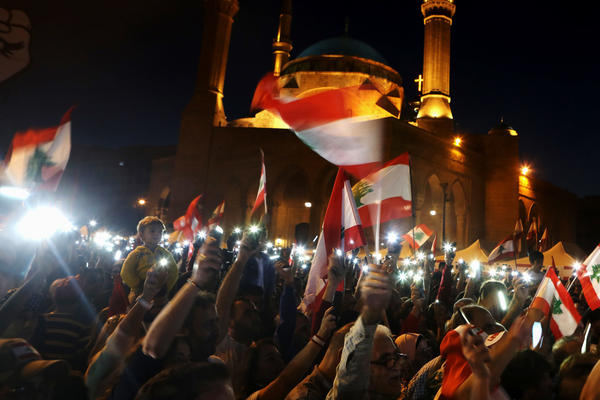 Lebanese anti-government protesters use the light on their mobile phones during a demonstration in downtown Beirut in November. Activists turned to social media platforms to get out their message, streaming protests live on Twitter and highlighting police abuse on Instagram. New podcasts documenting corruption launched with the protest movement.