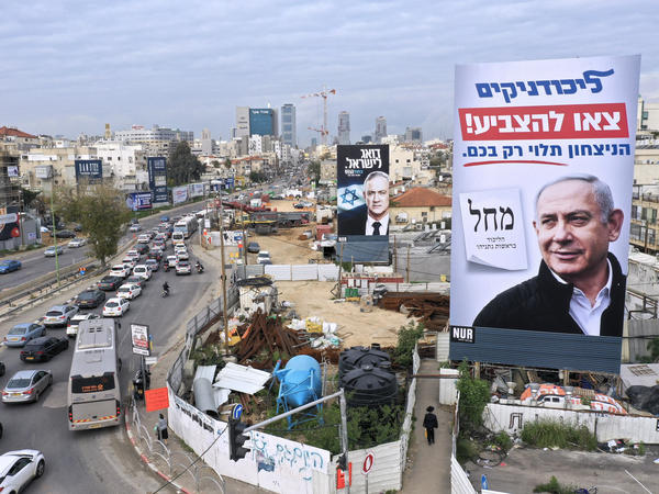 "Billboards show Benjamin Netanyahu (right) and rival candidate Benny Gantz in Bnei Brak, Israel, on Feb. 23. The sign in the foreground, for Netanyahu's Likud party, reads ""Likud members, go out to vote, victory depends only on you."""