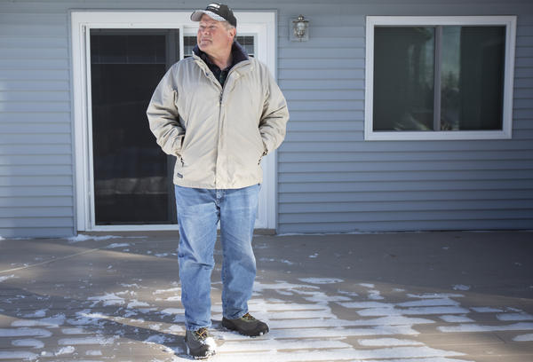 Seth Phillips poses for a portrait at his home in Kalkaska on Wednesday, Feb. 12. Phillips vehemently opposed Kalkaska County rescinding its point-of-sale septic inspection program.