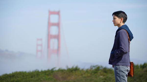 Lily (Sonoya Mizuno) contemplates the (golden) gates of perception in the moody, ruminative tech-thriller series <em>Devs</em>.
