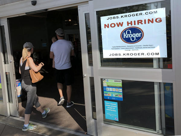 A hiring sign hangs in front of a Kroger's grocery store in Hilton Head, S.C. South Carolina has one of the lowest unemployment rates in the nation.
