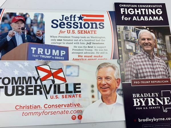 Leaflets for the candidates for a senate seat in Alabama are displayed on a table. Prominent among them is former Alabama Sen. and Attorney General Jeff Sessions.