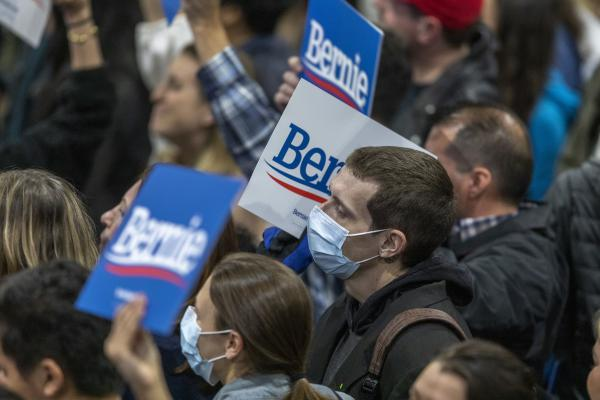 Supporters wear medical masks, as fears of coronavirus increase in California, during a campaign rally for Presidential candidate Sen. Bernie Sanders in Los Angeles on March 1, 2020.