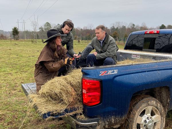 Shelley Proffitt (left) at her family farm in rural Kings Mountain, N.C. with producer Danny Hajek (center) and <em>Morning Edition</em> host Steve Inskeep.