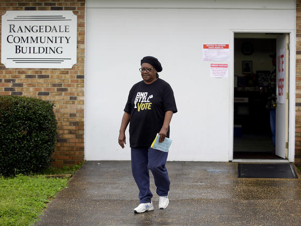 A voter leaves the Rangedale Community Building during the presidential primary in Selma, Ala., on Super Tuesday.