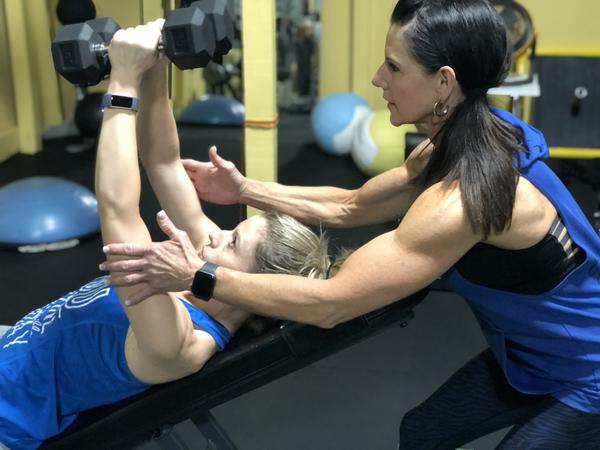 Pam Waugh, owner of Body Fit Training Facility, trains Renae Goodwin of Commercial Point
