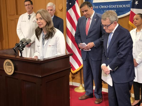 Dr. Amy Acton, Ohio Department of Health director, with Gov. Mike DeWine (R-Ohio)