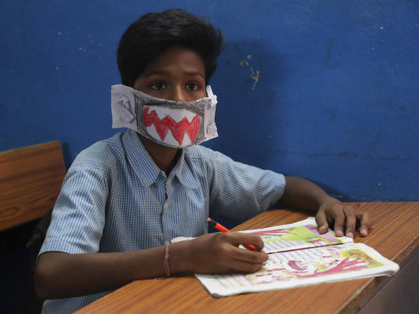 An Indian student wears a self-made mask during class in Hyderabad, India, on Wednesday. The country has reported at least 29 cases of the virus.