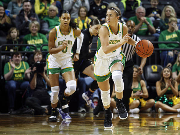 Oregon guard Sabrina Ionescu, right, drives downcourt against Washington during an NCAA college basketball game in Eugene, Ore., on Sunday.