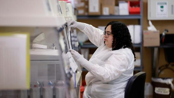 Aubrey Holland, performs tests at the Bureau of Public Health Laboratories on Monday, March 2, 2020, in Miami, where the COVID-19 virus is being tested at the Bureau of Public Health Laboratories.