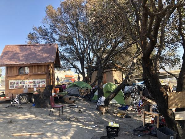 This tent camp is nestled between a freeway, rail tracks and a Burger King near the Fruitvale section of Oakland.