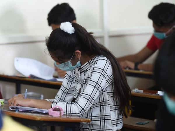 Students sit for an exam in Ahmedabad, India, on Thursday. In the nation's capital, New Delhi, all primary schools have been ordered closed until March 31 because of coronavirus concerns.