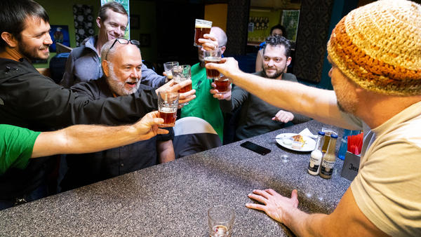 Appalachian Brew Club members cheer to 10 years since the club formed. They meet every month to talk and taste beer.