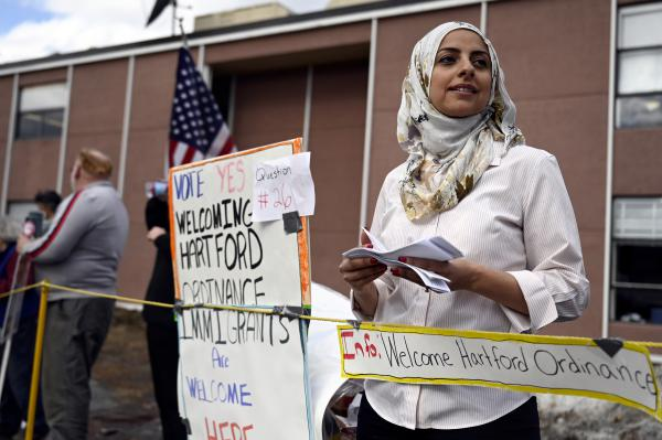 "Asma Elhuni, 43, of Hartford, Vermont, is a community organizer urging a ""yes"" vote on Question 26 at the Hartford High School on March 3, 2020, in White River Junction, Vermont."