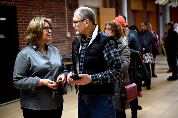 Patti Ayer, at left, and her husband Dave Ayer of Kittery, Maine, are first in line to vote at the Kittery Community Center on March 3, 2020.