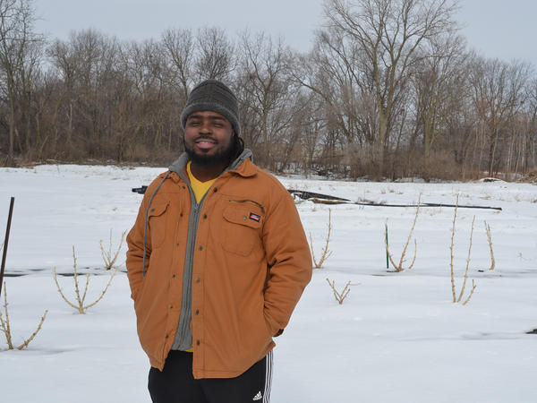 Demarkius Medley stands in front of where his hemp crop grew last year.