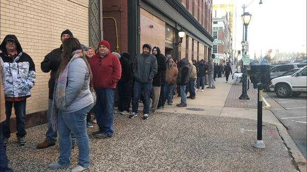 Customers line up outside HCI Alternatives dispensary in Springfield on Jan. 1
