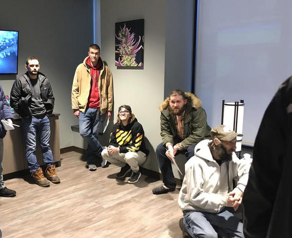 Customers wait to be called into the dispensary checkout area at HCI Alternatives in Springfield on Jan. 1