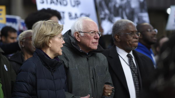 Democratic presidential candidates Elizabeth Warren and Bernie Sanders chat during a Martin Luther King Jr. Day march in January in Columbia, S.C.