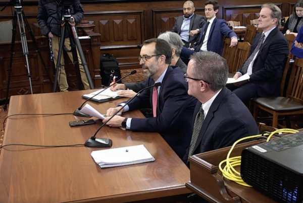 Rob Gramlich of the Illinois Commerce, center, and other energy policy representatives testify before an Illinois Senate committee on Mar 6