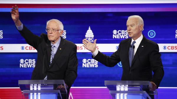 Sen. Bernie Sanders and former Vice President Joe Biden, seen here at the South Carolina Democratic debate, square off Tuesday in states including Michigan and Washington.