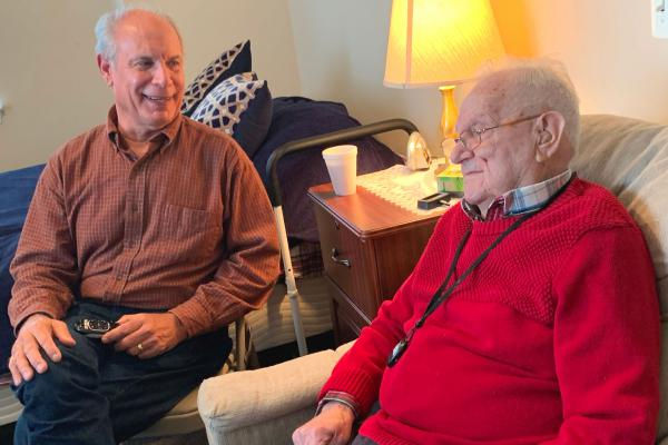 Gene Popiolek, 68, (left) visits his father Bernie, 95, at an assisted living facility outside Baltimore. Bernie, a WWII veteran, pays to live here with help from the VA's Aid and Attendance benefit.