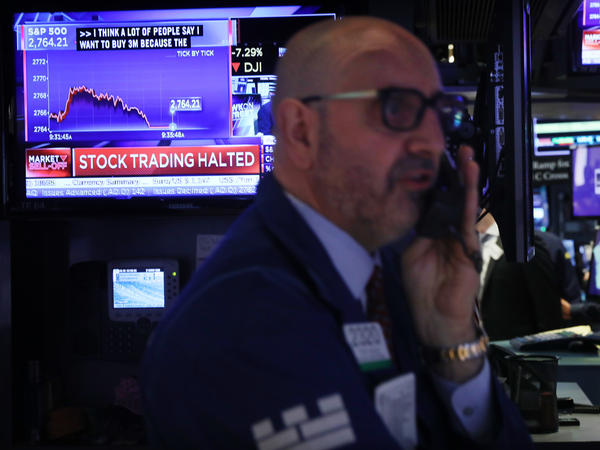Trading on the New York Stock Exchange was halted briefly Monday morning when the S&P 500 index fell 7%, triggering automatic circuit breakers.