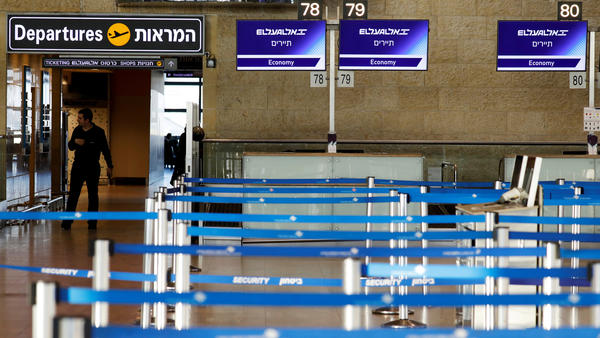 Israel has announced a blanket quarantine policy for anyone entering the country; the policy will be in effect for two weeks. Here, empty airline check-in counters are seen at Ben Gurion Airport, near Tel Aviv.