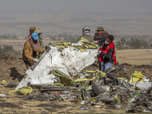Rescuers work at the scene of the Ethiopian Airlines 737 Max crash south of Addis Ababa, Ethiopia last year.