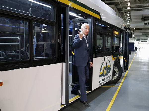 Then-Vice President Joe Biden exits after touring a new bus in Detroit in September 2015.