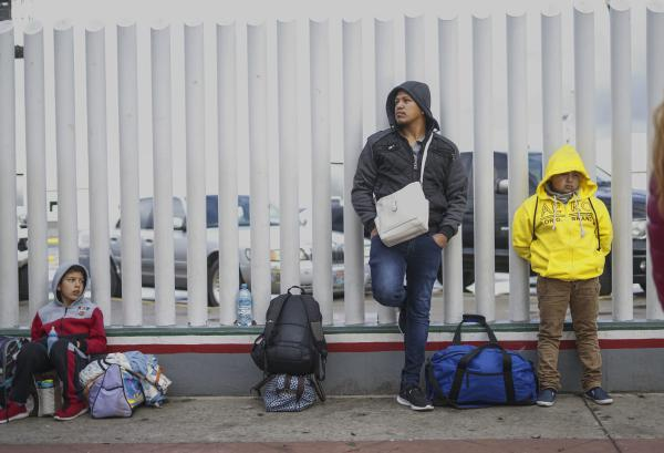 Honduran migrants wait in line to plead their asylum cases at the El Caparral border crossing on March 2, 2020 in Tijuana, Mexico. (Sandy Huffaker/Getty Images)