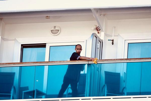 A worker at Port Everglades in Fort Lauderdale cleans railings of the Regal Princess on Tuesday.