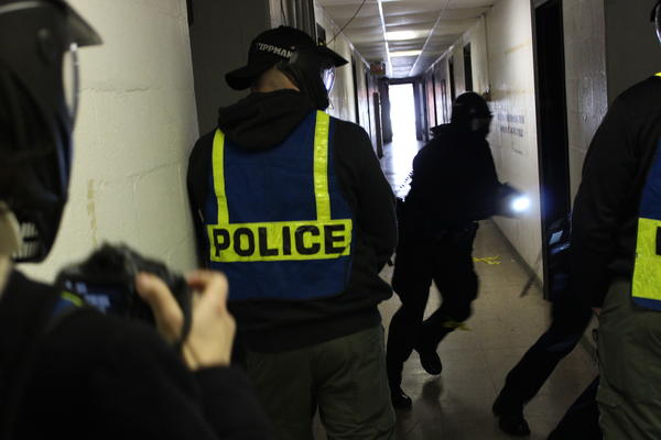 In an abandoned building Dayton Police recruits simulate a school shooting.