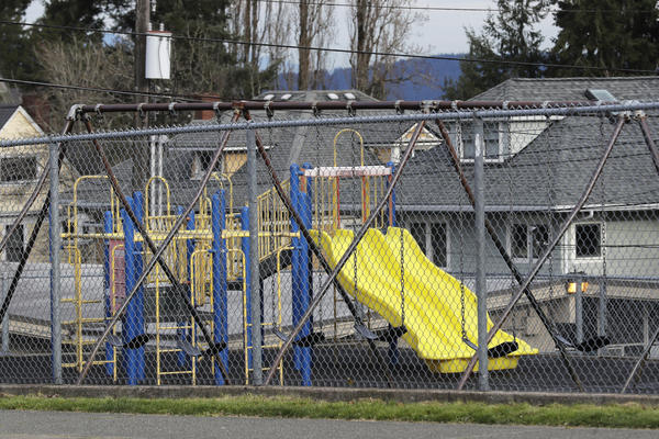 The playground at Lowell Elementary School in Tacoma, Wash., sat empty on Tuesday. According to Tacoma Public Schools, Lowell was closed after someone at the school tested presumptive positive for the novel coronavirus.