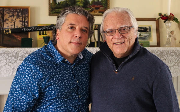 Tom J. Germano (right) told his son, Thomas Germano, about when he took part in the Great Postal Strike of 1970 to demand better pay, during a visit to <em>StoryCorps</em> last month in North Babylon, N.Y.
