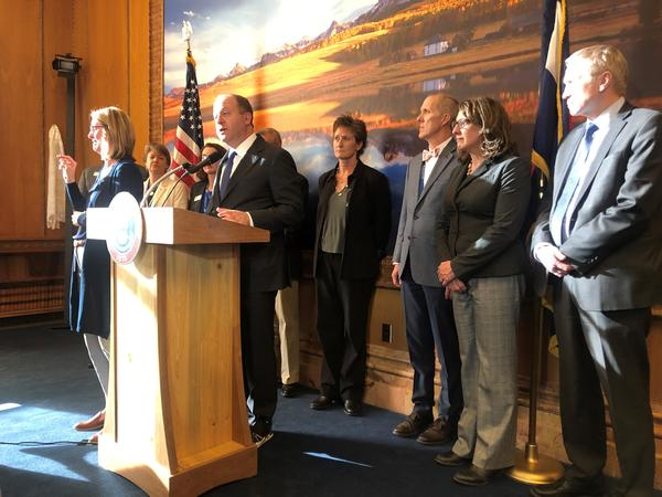 Gov. Jared Polis and state health officials talk to reporters about the spread of COVID-19 in the state.