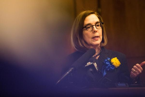<p>Oregon Gov. Kate Brown speaks to reporters in her ceremonial office at the Capitol in Salem, Ore., Monday, Jan. 14, 2019.</p>