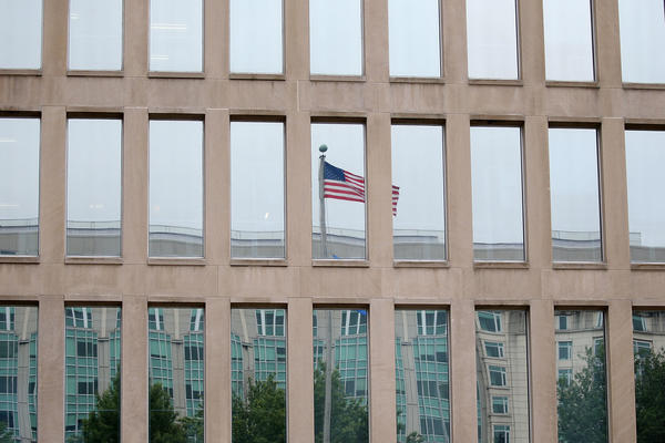 The White House is taking a different view on telework as the Office of Personnel Management, housed in the Theodore Roosevelt Federal Building, tells agencies to incorporate the practice into contingency plans.