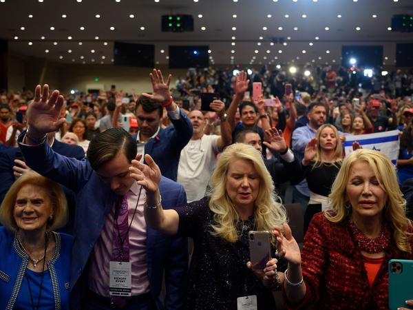 "Supporters pray as President Donald Trump speaks during an ""Evangelicals for Trump"" campaign event held at the King Jesus International Ministry on Jan. 03, 2020 in Miami."