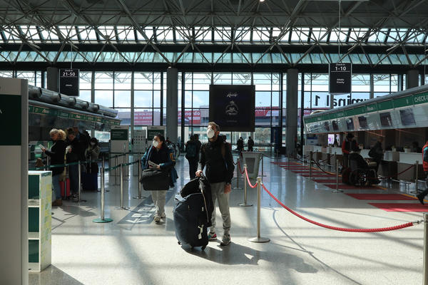 A passenger checks flight information at Fiumicino airport in Rome, Italy. President Trump imposed a 30-day ban on most travelers coming from from European countries, beginning late Friday E.T.