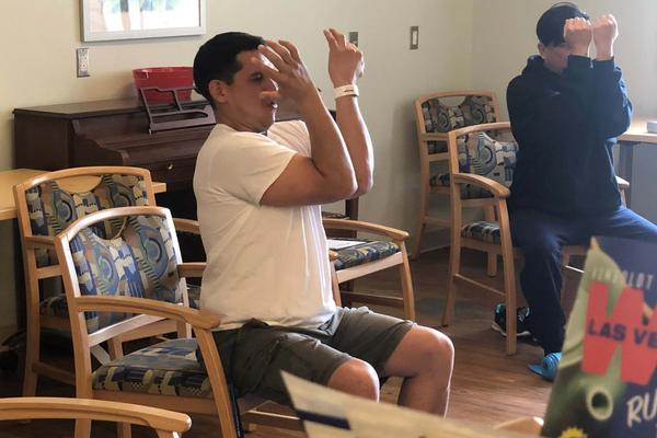Veterans Jim Romero (left) and Ronnie Reyes practice yoga as part of their treatment at the VA Southern Nevada Health Care Center in Las Vegas. The newly opened center is the second inpatient gambling treatment facility in the VA system.
