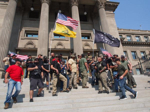 Gun rights supporters, including militia members, rally in support of gun rights in September 2018 during an event put on by the Idaho Second Amendment Alliance. The alliance and groups like it around the country have been pushing back against efforts to increase gun regulations in the wake of high rates of gun violence.