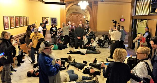Medicaid expansion protestors demonstrating at the Statehouse earlier this week
