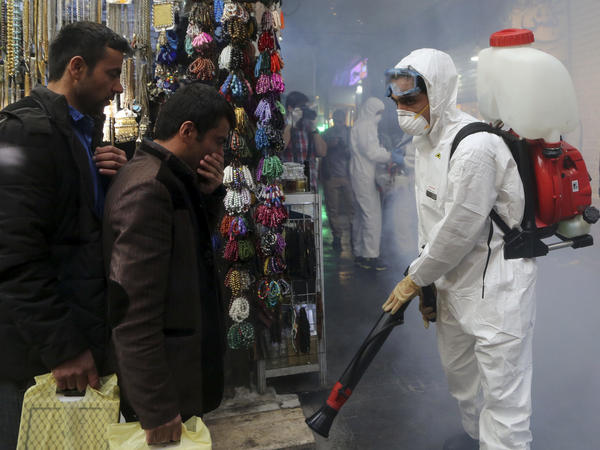 Firefighter teams with protective suits disinfect the Tajrish Bazaar as a precaution against the coronavirus in Tehran, Iran, on March 6.