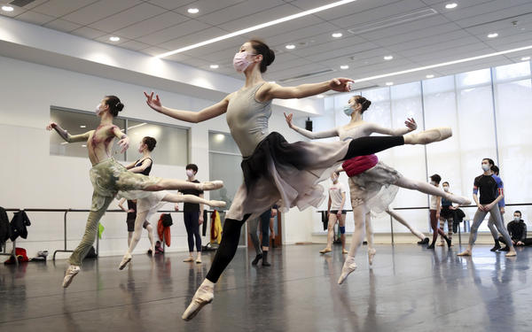 Ballet dancers in Shanghai rehearse while wearing masks on March 2. A virus first identified in December has altered daily life and public spaces around the globe.