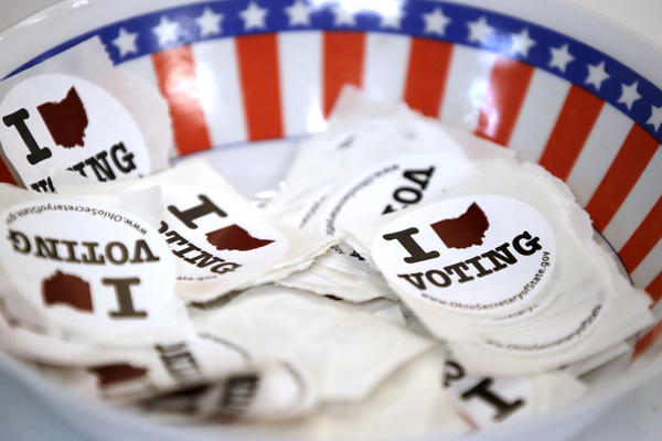 A bowl of stickers for those taking advantage of early voting, Sunday, March 15, 2020, in Steubenville, Ohio.