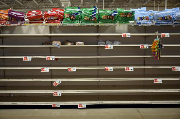 Nearly bare shelves of bread are seen at ShopRite in Canton, Connecticut on March 13, 2020. Many Connecticut stores have seen shoppers stock up on supplies and food amid the coronavirus health crisis.